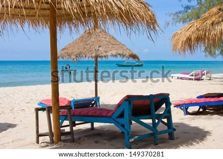 Beautiful tropical beach with deck chairs, Thailand - stock photo