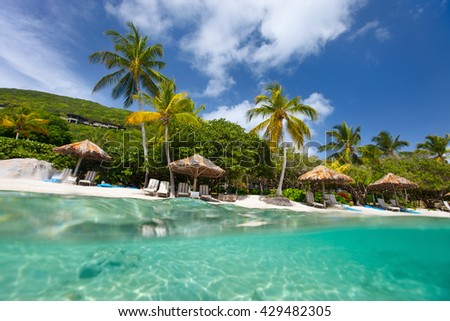 Beautiful Tropical Beach With Palm Trees White Sand Turquoise Ocean Water And Blue Sky