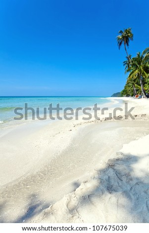 Beautiful tropical beach with  sea view, clean water & blue sky. Nature background - stock photo