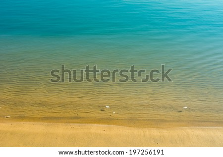 beautiful tropical blue green water and a  sand beach for background - stock photo