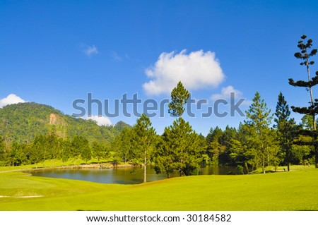 Beautiful Tropical Golf Course with Lake - stock photo