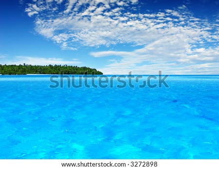 Beautiful Tropical Island in the distance - stock photo