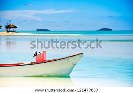 Beautiful Tropical Lagoon with boat in the foreground - stock photo