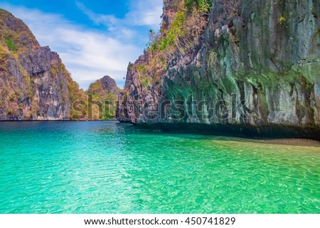 Beautiful tropical landscape with blue lagoon and rocky island, El Nido, Palawan, Philippines - stock photo