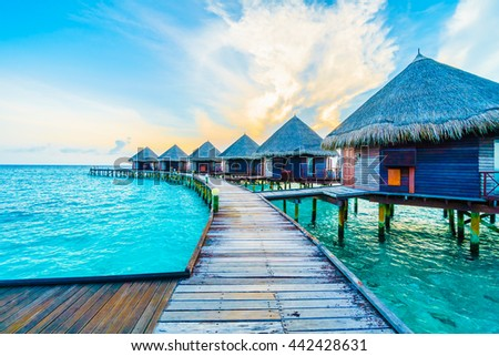 Beautiful tropical Maldives resort hotel and island with beach and sea on sky for holiday vacation background concept -Boost up color Processing