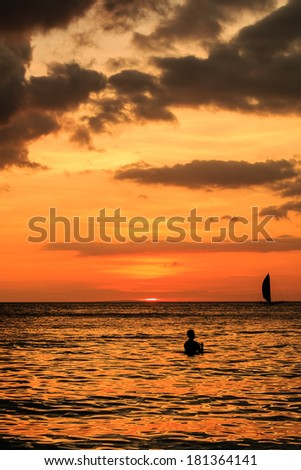 Beautiful tropical ocean sunset with reflection - stock photo