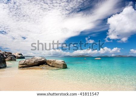 beautiful tropical rocky beach in caribbean waters - stock photo