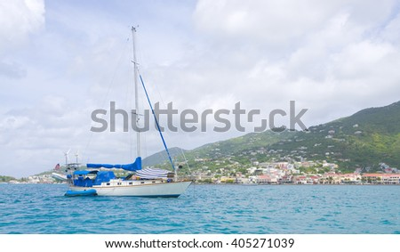 Beautiful Tropical scene of a sail boat on the port of the Ameriacn Virgin Islands - stock photo