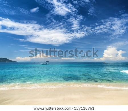 Beautiful tropical sea and blue sky. - stock photo