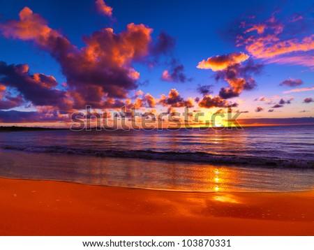 Beautiful tropical sunset on the beach - stock photo