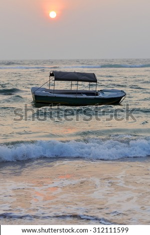 Beautiful tropical sunset with boat in Sri Lanka
