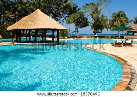 beautiful tropical swimming pool - stock photo