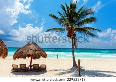 Beautiful tropical white sand beach and Caribbean sea in Tulum Mexico - stock photo