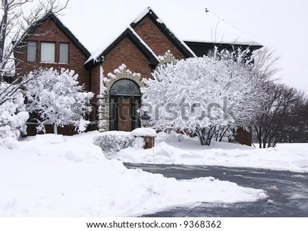 Beautiful tudor and brick home - stock photo