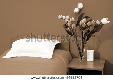 Beautiful tulips at a bed with an coverlet - stock photo