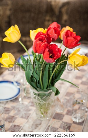 Beautiful tulips bouquet on vase on the table - stock photo