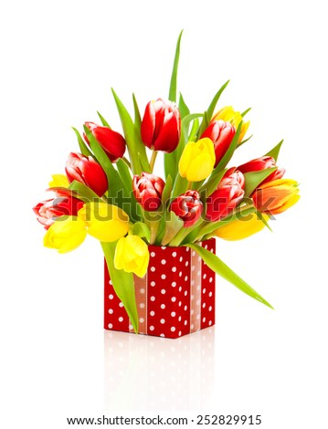 beautiful tulips in the red polka-dot gift box. happy mothers day, romantic still life, fresh flowers - stock photo