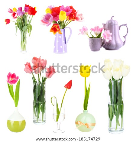 Beautiful tulips in vases isolated on white - stock photo