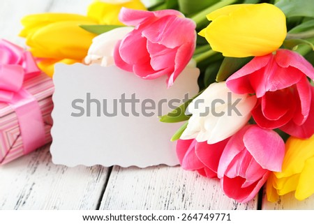 Beautiful tulips on white wooden background - stock photo