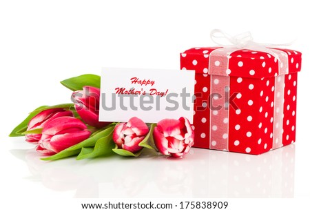 beautiful tulips with red polka-dot gift box. happy mothers day, romantic still life, fresh flowers - stock photo