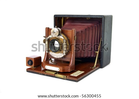 Beautiful turn-of-the-century wooden view camera with red bellows - stock photo