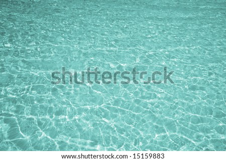 Beautiful turquoise clear water of a tropical sea - background - stock photo