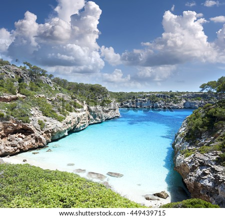 Beautiful turquoise clear water of mediterranean at Majorca beach Calo des Moro, Spain
