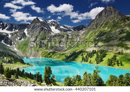 Beautiful turquoise lake in Altai mountains - stock photo