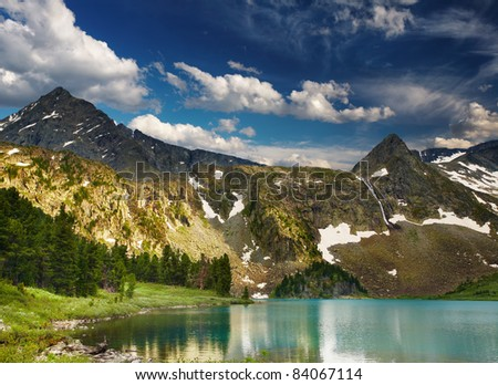 Beautiful turquoise lake in altai mountains at sunset - stock photo