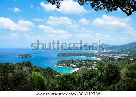 Beautiful turquoise ocean waves with boats and coastline from high view point. Kata, Karon and Patong beaches Phuket Thailand - stock photo