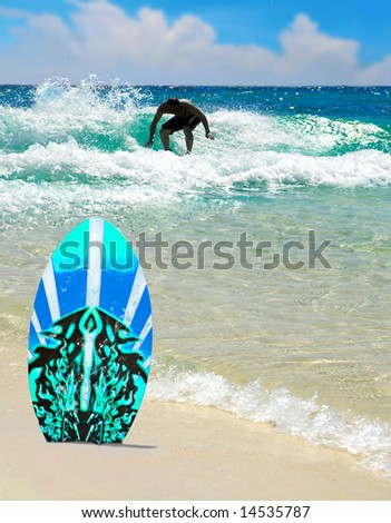Beautiful turquoise sea with surfer on waves by surfboard - stock photo