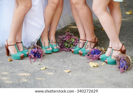 beautiful turquoise shoes of the bride and bridesmaids and wedding bouquets. - stock photo