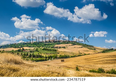 Beautiful Tuscany landscape with the old town of Pienza on a hill in the background in summertime, Val d'Orcia, Italy - stock photo