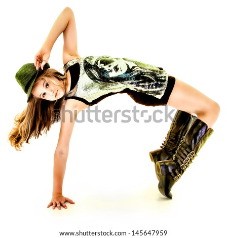 Beautiful Tween Girl Dancing Hip Hop in Studio Over White - stock photo