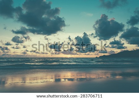 Beautiful twilight over the sea - soft focus with film filter - stock photo