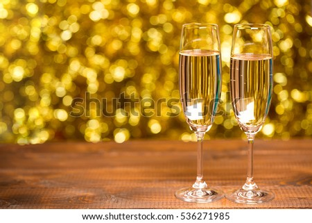 Beautiful two glasses of champagne standing on the table in the background of a blurred. Soft focus.