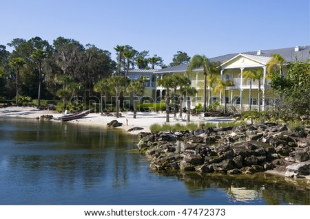 Beautiful two story yellow condominiums on a beach - stock photo