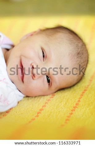 beautiful two weeks old baby girl smiling. Please check portfolio for more baby images.