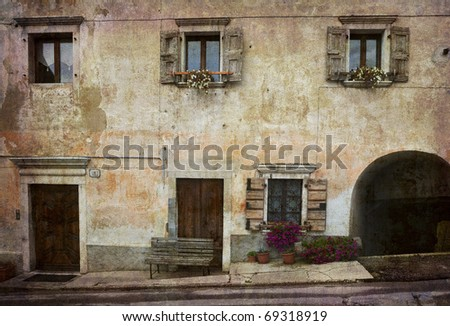 Beautiful typical facade in a little village in northern Italy. More of my images worked together to reflect time and age. - stock photo