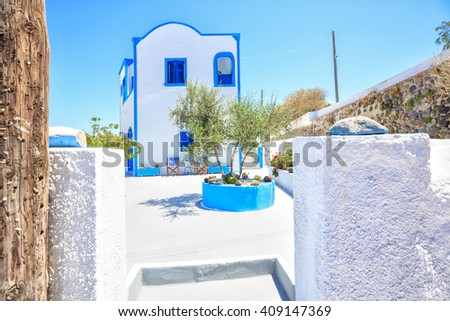 Beautiful typical greek house with olive tree in front of entrance. Thira, Santorini island, Greece