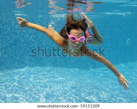 Beautiful underwater girl in the swimming pool - stock photo