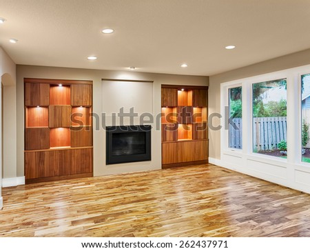 Beautiful unfurnished living room with hardwood floors in new luxury home - stock photo