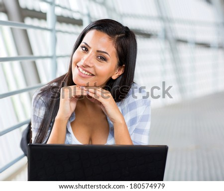 beautiful university student with a computer