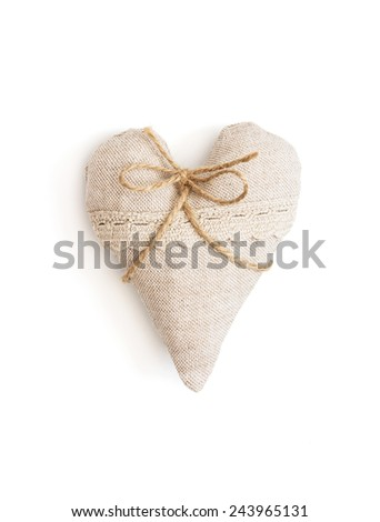 Beautiful valentine heart of fabric with ribbon isolated on a white background. - stock photo