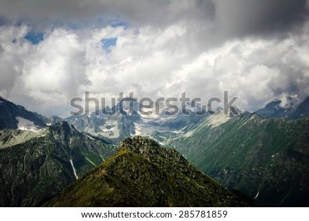 Beautiful valley and peaks in Caucasus mountains, the Main Caucasian ridge. North Caucasus - stock photo