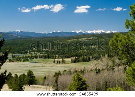 Beautiful valley, near Angel Fire, New Mexico, looking toward Wheeler Peak and Sangre de Cristos range - stock photo