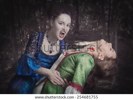 Beautiful vampire woman in blue medieval dress and her victim outdoor - stock photo