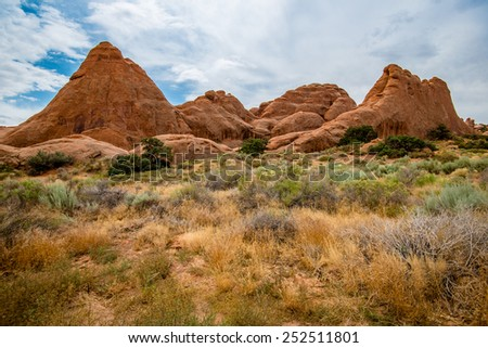 Beautiful variety of mountains and unique rocks in Arches National Park - stock photo