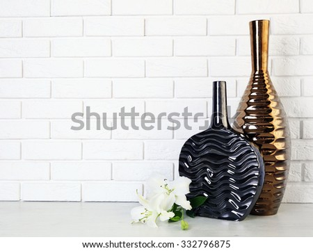 Beautiful vases on brick wall background - stock photo