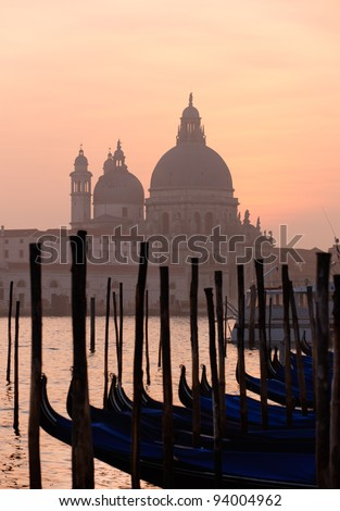 Beautiful Venice, Grand Canal famous church of Santa Maria della Salute at sunset - stock photo